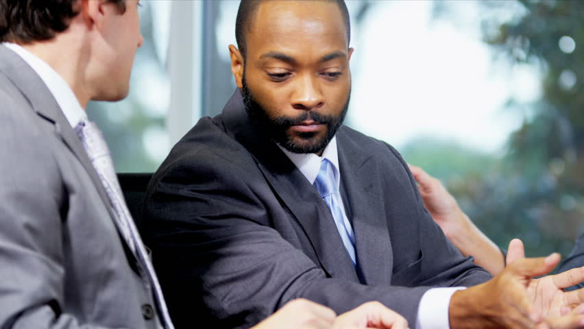 Male African American Business Consultant In Client Meeting Close