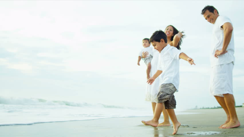 Young Hispanic loving family spending vacation on beach shot on RED EPIC