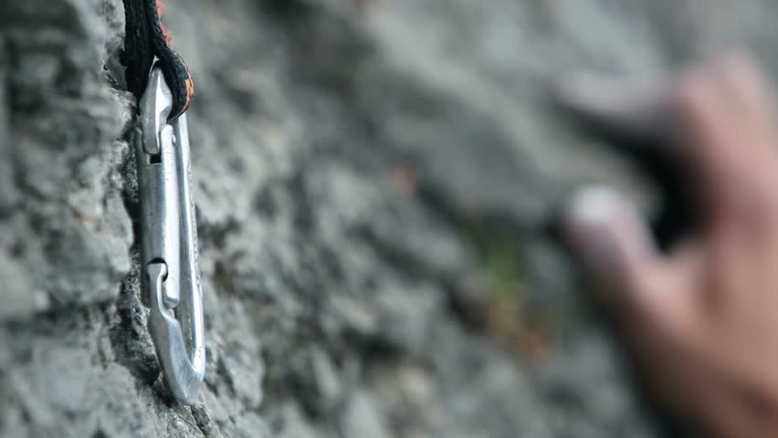 Close up of a hand rock climbing in nature
