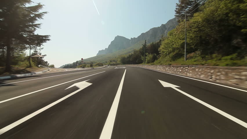 Driving car on coastal mountain road in direction of Yalta - Sevastopol pov.