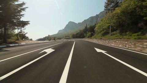 Driving car on coastal mountain road in direction of Yalta - Sevastopol pov.