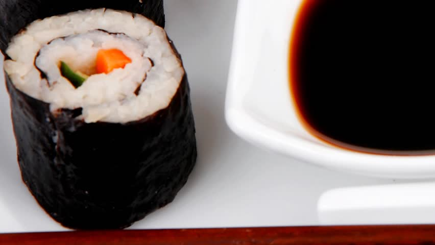 Japanese traditional Cuisine - Roll with Cucumber Cream Cheese with raw Tuna(maguro) and Salmon(sake) inside. dish with sticks 1920x1080 intro motion slow hidef hd