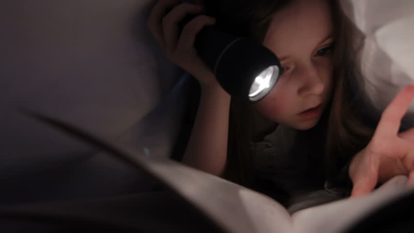 Child reading in bed - Little girl reading by torch light under the bed sheets | Shutterstock HD Video #3842975