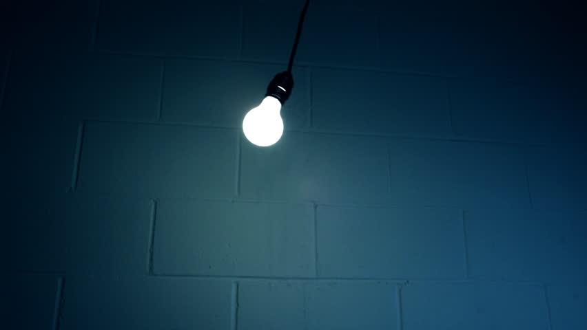 Swinging Light Bulb In Dark Stock Footage Video 100 Royalty Free 3853553 Shutterstock