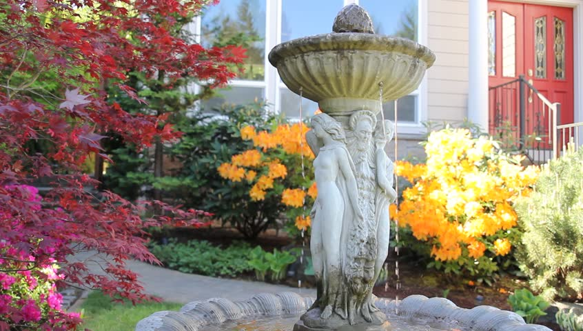 Water Fountain in Garden with Maple Trees and Flowering Azalea Plants in Spring Season 1920x1080