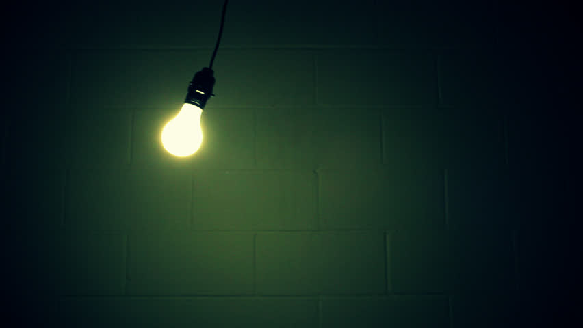Light Bulb Swinging in Dirty Dark Room - HD stock video clip
