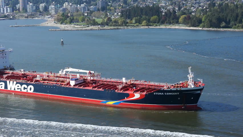 VANCOUVER, CANADA – MAY 07, 2013: Oil tanker enters Burrard Inlet on May 07, 2013. Crude oil tanker traffic is on the rise and creates increased risks of a major oil spill.