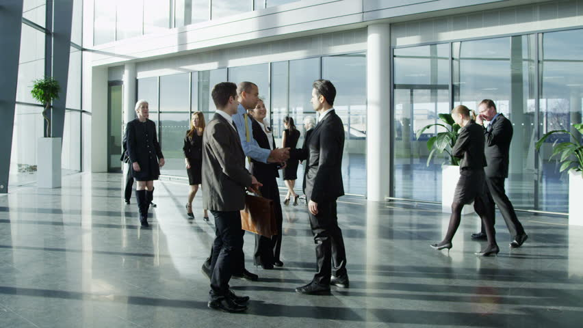 Confident and attractive young business team meet up with their client and shake hands, in a light and modern office building.  | Shutterstock HD Video #3870653