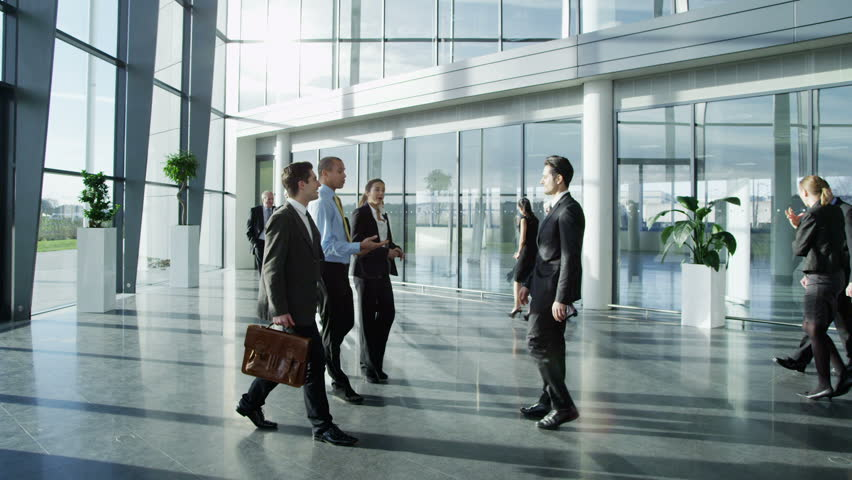 Confident and attractive young business team meet up with their client and shake hands, in a light and modern office building. In slow motion.  | Shutterstock HD Video #3870662