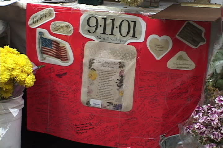 NEW YORK CITY - SEPTEMBER 29, 2001: Collage and hand-written messages left at 9/11 memorial outside Engine 23 fire station.