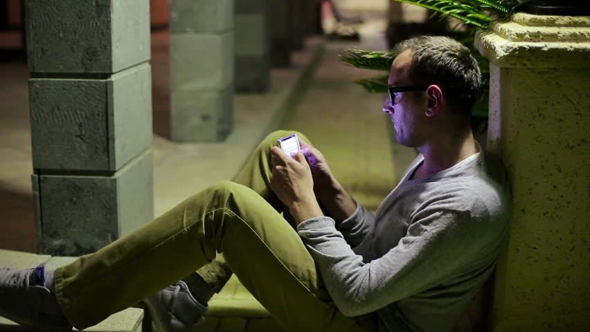 Young man using smartphone in the city  | Shutterstock HD Video #3885809