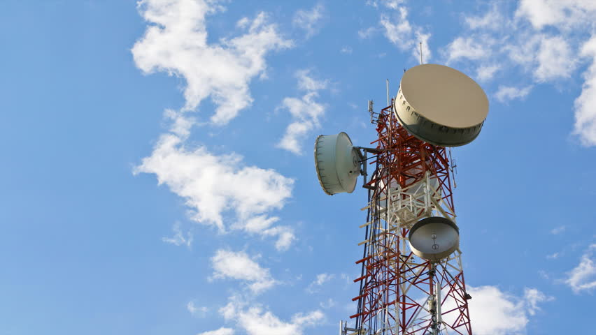 time lapse antenna communication tower and blue sky