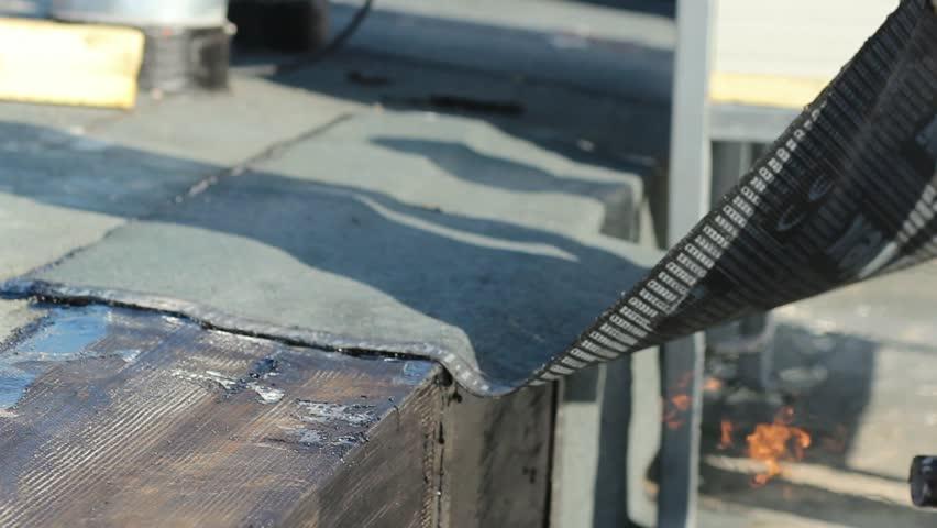 Flat Roof Installation   Roofers Applying Bitumen Stock Footage Video  3927449 | Shutterstock