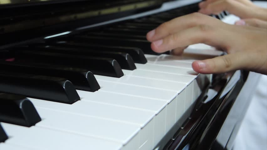 closeup hand while playing piano