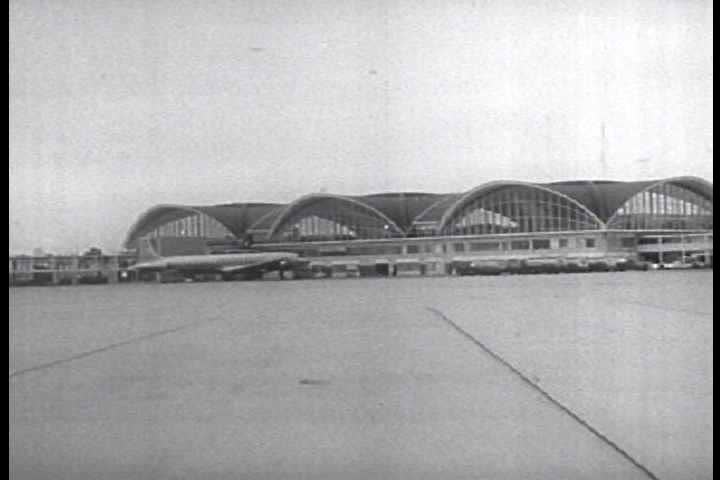 1950s - Plane flies over St. Louis then lands at Airport