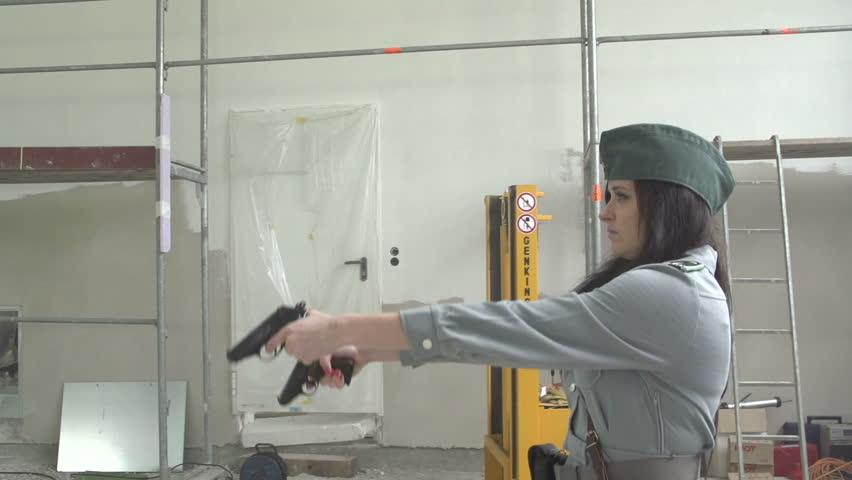 Female officer shooting 2 pistols