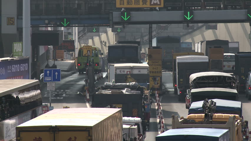 HONG KONG, CHINA - FEBRUARY 2012: Toll Gate Gridlock Traffic On Highway. Shot in Hong Kong in Full HD 1920x1080 30p on Sony EX1.   Shutterstock HD Video #3973693