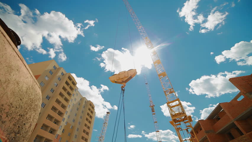 crane lifts building materials to the construction of multi-storey buildings