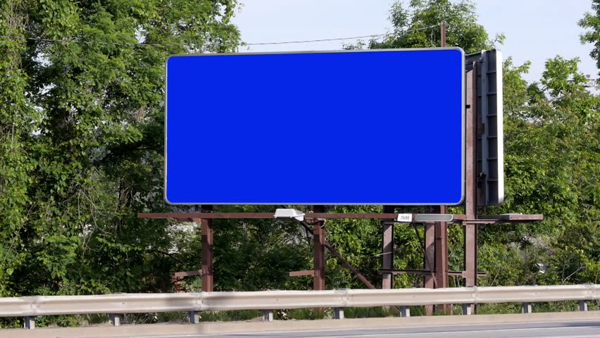 Cars pass a blank billboard.  Luma matte included for placement of your own content.