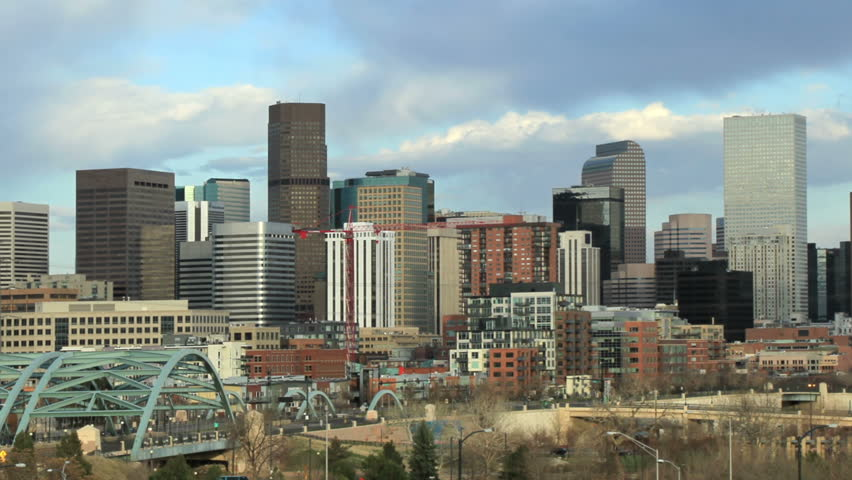 Busy afternoon traffic and skyline in downtown Denver, Colorado.  All logos removed for Commercial Use. HD 1080p.