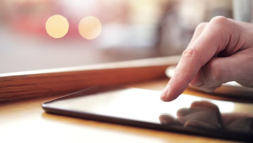 Man hand using tablet computer pc  commuter in background | Shutterstock HD Video #4052473