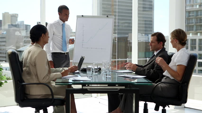 Business people discussing the presentation in the board room | Shutterstock HD Video #4055263