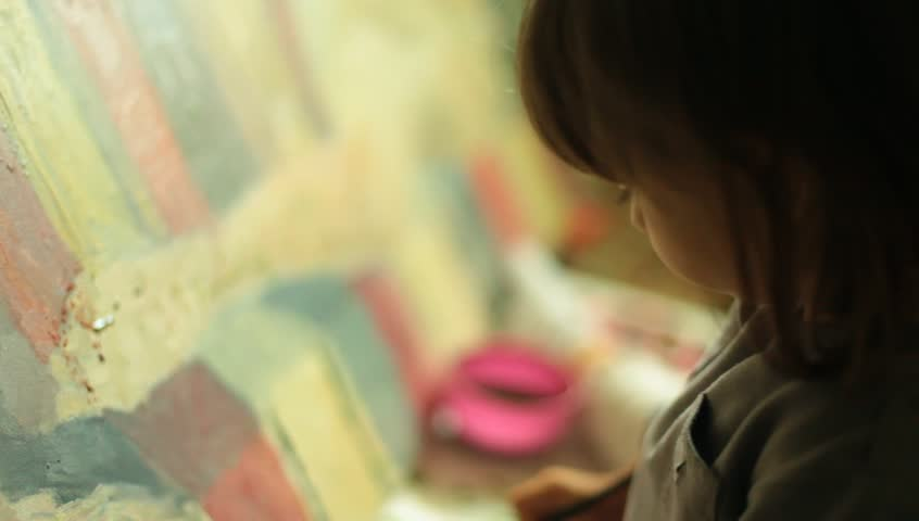 Little baby girl infant paints water colors with brush.  | Shutterstock HD Video #4058803