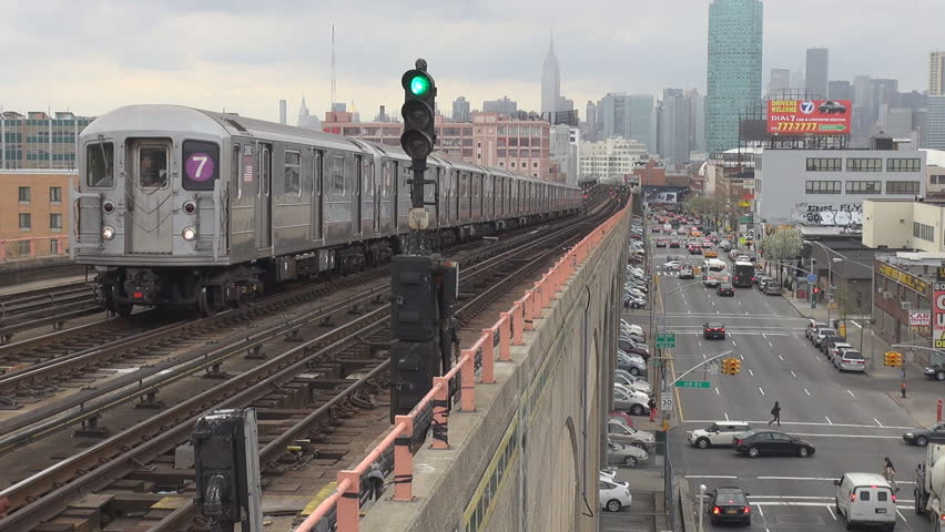 NEW YORK - USA, APRIL 21, 2013, Metro train and traffic car by day