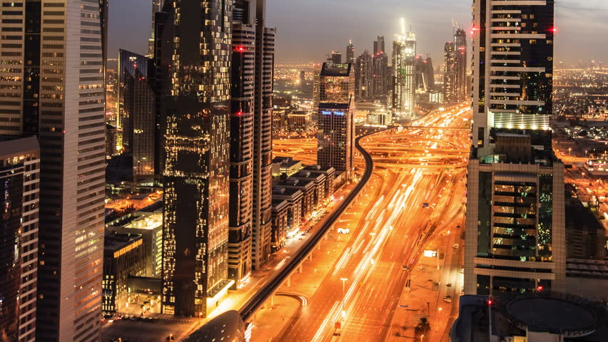 DUBAI, UNITED ARAB EMIRATES, MARCH 11th: Busy traffic scene in the rush hour on Sheikh Zayed Road, Dubai's main road artery. Transition time-lapse from dusk to night in Dubai, March 11 2011