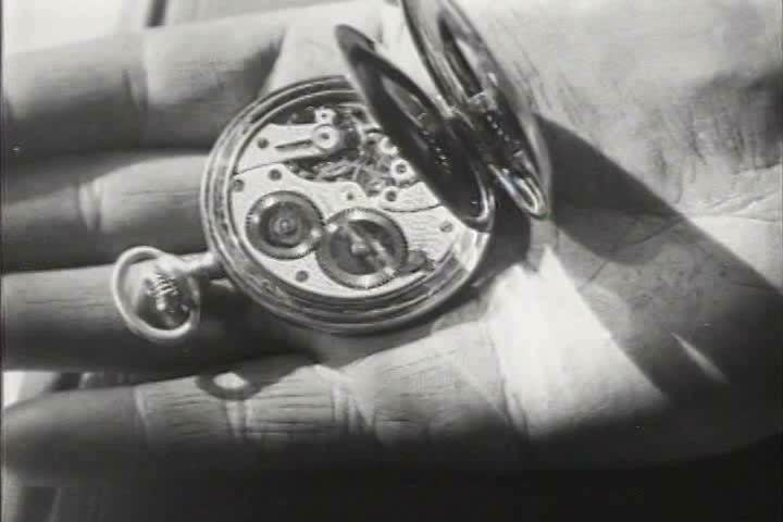 1910s, 1920s - Close up of a hand and a pocket watch