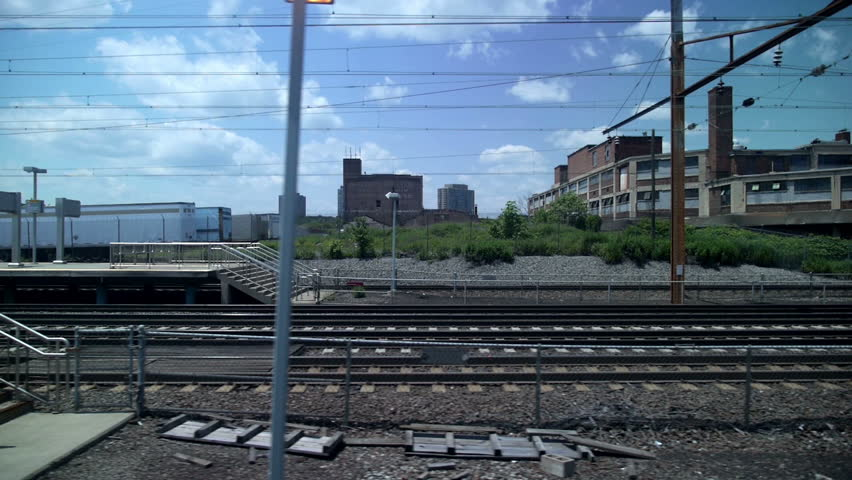 Looking out the window of a train or subway at the New Jersey landscape.