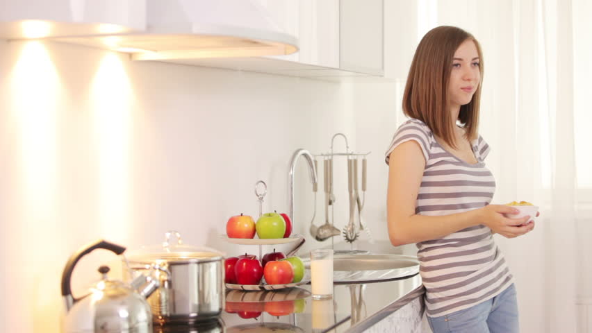 Woman Standing In Kitchen And Eating Cornflakes Stock Footage ...