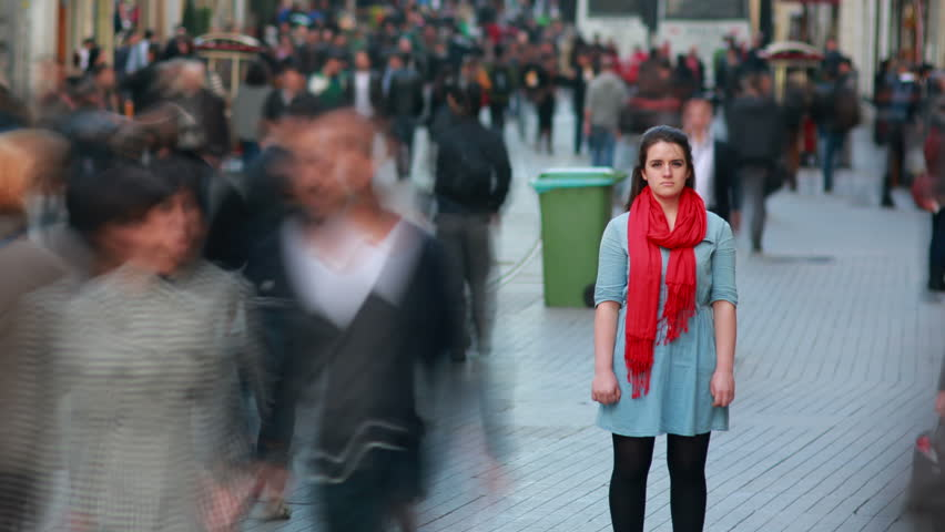 Young woman standing in busy city street, fast motion time lapse #4106353
