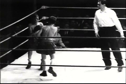 1940s - An amateur boxing match in 1948. includes child boxers.