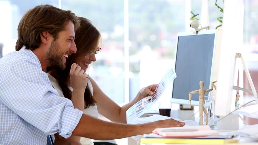Business people laughing and talking together | Shutterstock HD Video #4115083