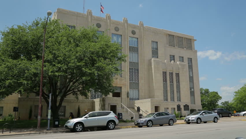 AUSTIN, TEXAS/USA - MAY 10: Traffic passes historic building, Travis County Court House on Guadalupe Street on May 10, 2013 in Austin.