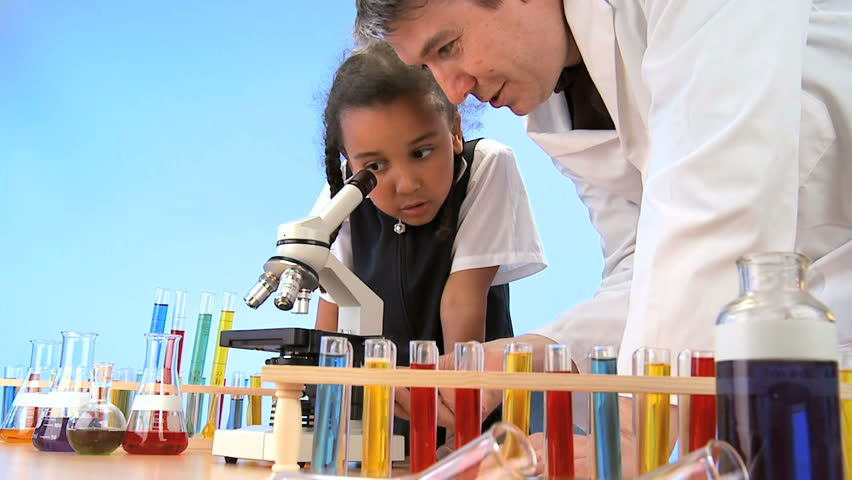 Teacher & pupil in elementary school science laboratory