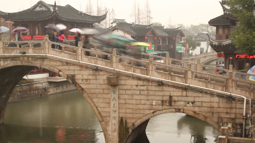 SHANGHAI - DECEMBER 16: Qibao Ancient Town stone arch bridge and wooden boat,