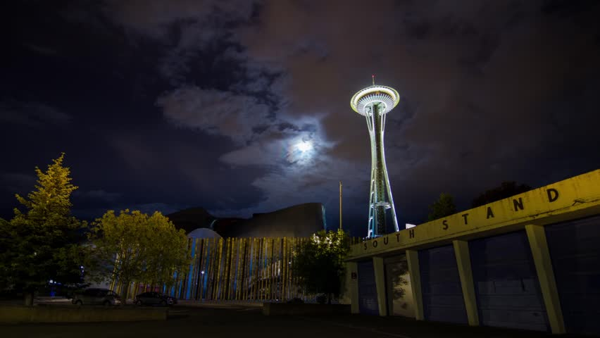 Time Lapse on a Cloudy Night in Seattle by the Space Needle with Moon Rising