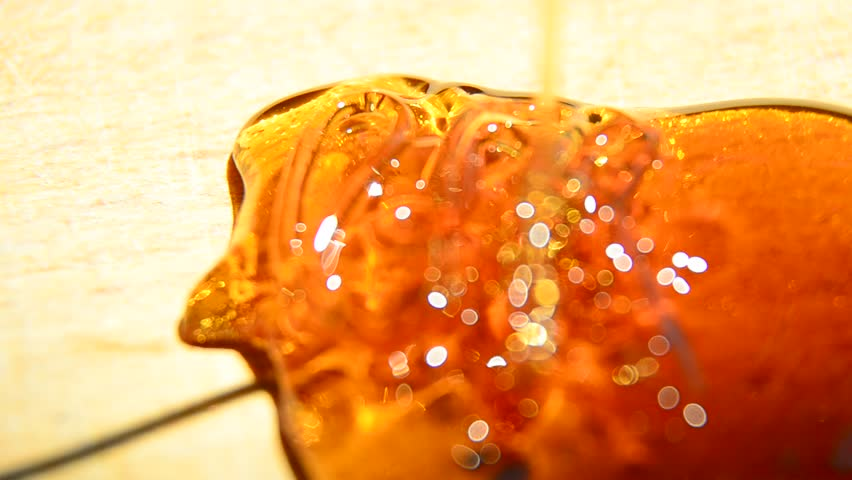 Honey pour closeup, Closeup of honey pouring