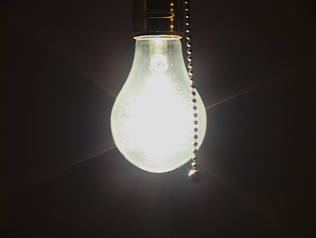 Close Up Of Tungsten Light Bulb Being Turned Off To Black