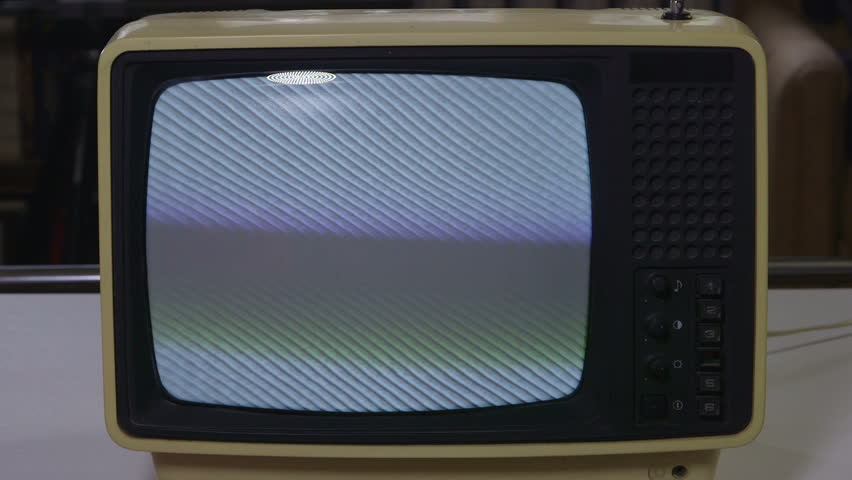 Watching vintage television close-up