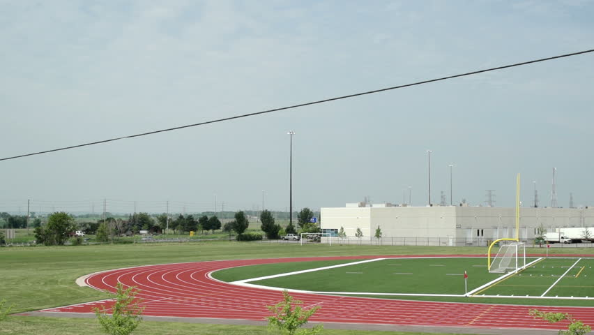 Outdoor Sports Field / Left - to Right pan across combination sports field for track and field, soccer and football. Not graded.
