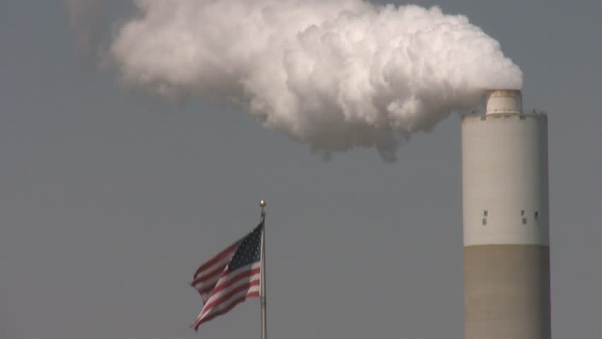 smoke stack and american flag