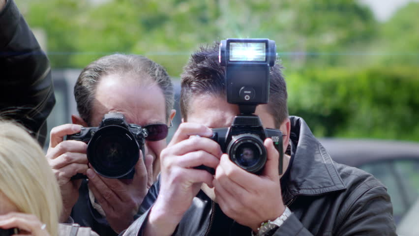Celebrity Being Photographed By a Large Group of Paparazzi | Shutterstock Video #4208857