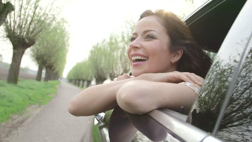 Young woman enjoying rural car ride