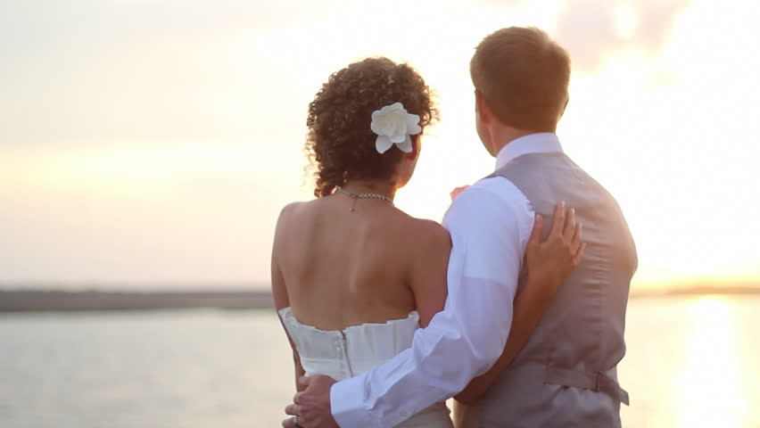 Newly wed couple watch sunset  | Shutterstock HD Video #4224313