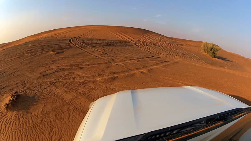 4x4 off road land vehicle taking tourists on desert dune bashing safari, Middle East