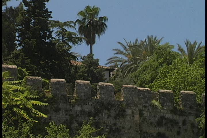 Closeup of a Medieval Selcuk defense wall with crenelations and loopholes in perfect conditions