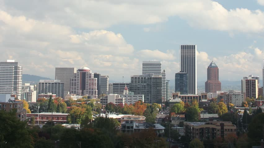 Portland Oregon Cityscape in Colorful Fall Autumn Season and Fast Moving White Clouds against Blue Sky with Panning Effect Timelapse 1920x1080 | Shutterstock HD Video #4252613
